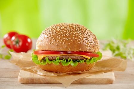 fresh hamburger on wooden cutting board photo