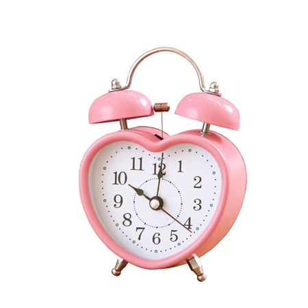 pink clock on white background photo
