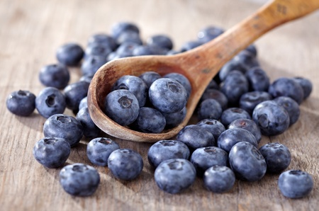 fresh blueberries in wooden spoon Stock Photo - 10260134