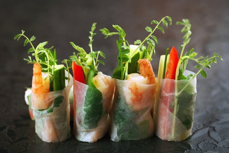 vietnamese food: vietnamese rice paper rolls with prawns and vegetables Stock Photo