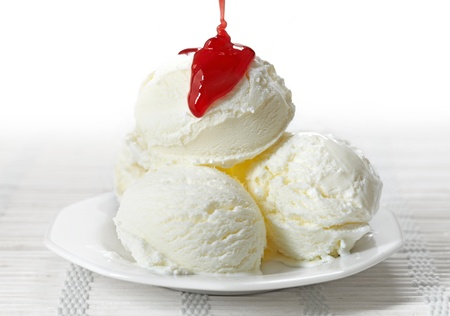 Ice cream with strawberry jam photo