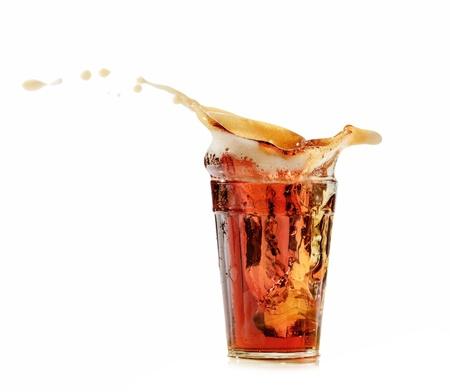 soda pop: cola glass and cola splashing Stock Photo