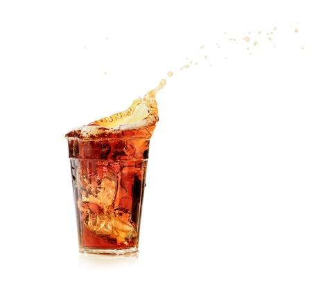 cola glass and cola splashing photo