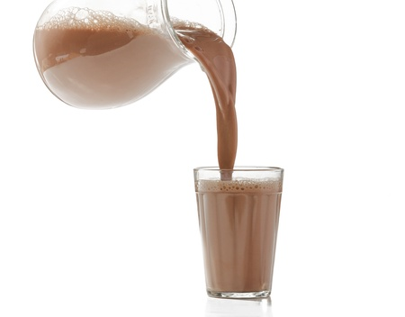 pouring milk chocolate into a glass photo
