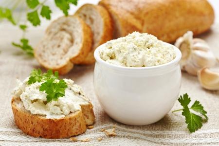 sandwich spread: fresh cream cheese and bread Stock Photo