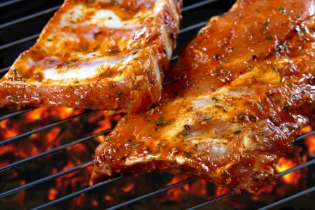 raw pork ribs on grill photo