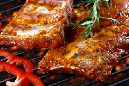 bbq ribs: raw pork ribs on grill