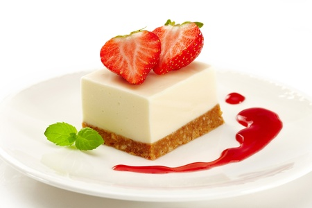 dessert plate: cheesecake with strawberries on white plate
