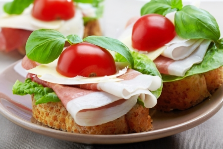 Sandwich with prosciutto, parmesan cheese and tomato Stock Photo - 16325418