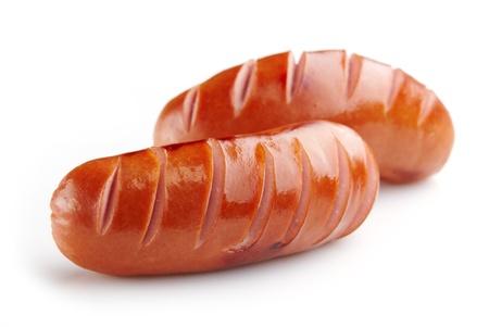 saucisses grillées sur fond blanc Banque d'images