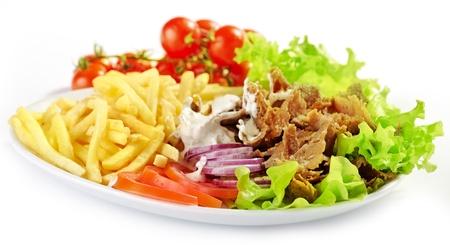 gyros: Plate of kebab and vegetables