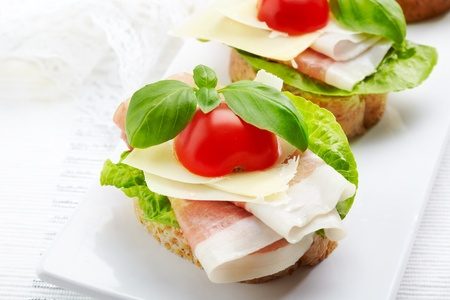 Sandwich with prosciutto, parmesan cheese and tomato Stock Photo - 16983807