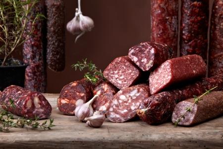 hang up: various salami sausages Stock Photo