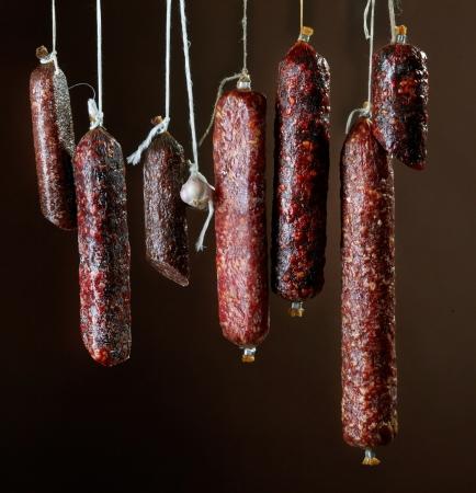 salami: various hanging salami sausages