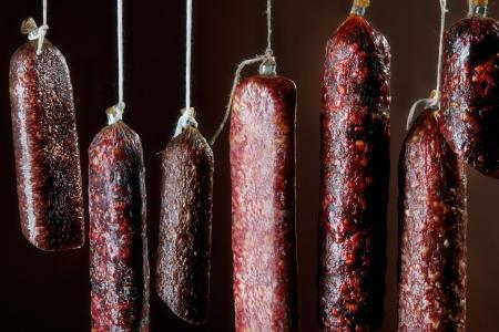 air dried salami: various hanging salami sausages