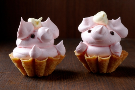 funy: pig shaped cupcake on dark brown table