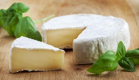 moldy: camambert cheese on wooden cutting board Stock Photo