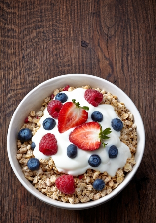 crunchy: bowl of muesli and yogurt with fresh berries