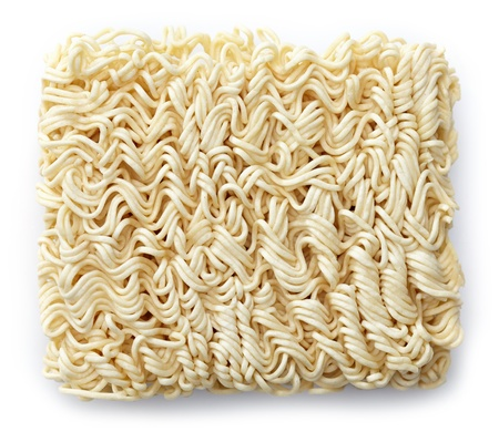 raw chinese noodles on white background photo