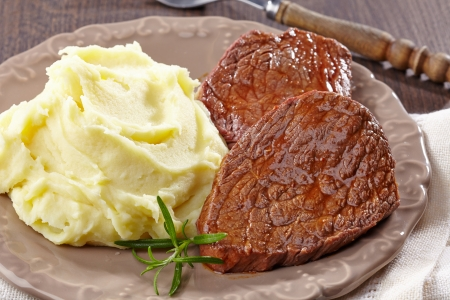 potato leaves: Mashed potatoes and beef steak on plate