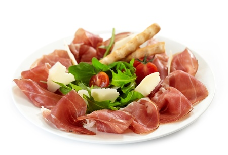 antipasti: Plate of prosciutto and parmesan  Stock Photo