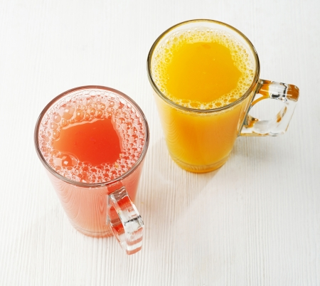 Freshly squeezed orange and red grapefruit juice photo