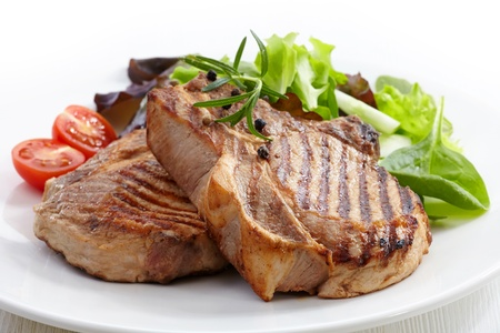 Grilled meat steak and fresh vegetables salad photo