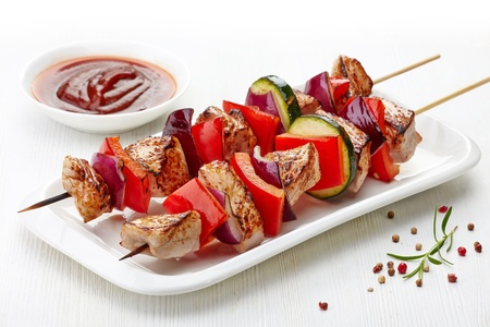 meat skewers:  grilled pork fillet and vegetables on white background, pork barbecue Stock Photo