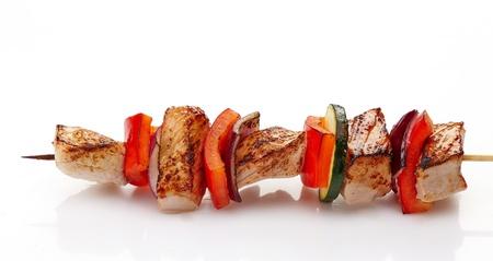 kabob:  grilled pork fillet and vegetables on white background, pork barbecue Stock Photo