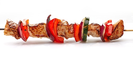 grilled pork fillet and vegetables on white background, pork barbecue Stock Photo