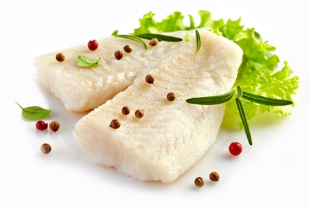 food fish: prepared pangasius fish fillet pieces and spices