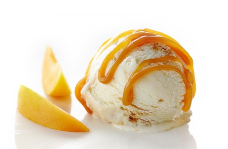 caramel: scoop of ice cream and apricot on white background