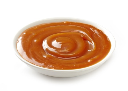 caramel sauce: sweet caramel sauce on a white background