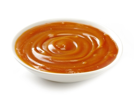 toffee: sweet caramel sauce on a white background