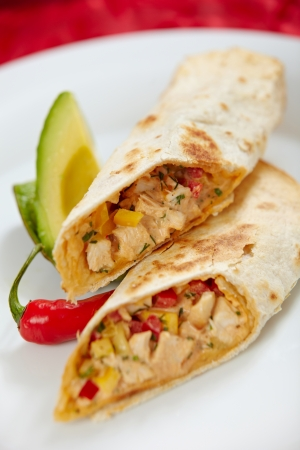 fajita: tortilla wraps with chicken meat and vegetables