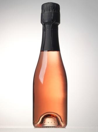 bottle of pink sparkling wine photo