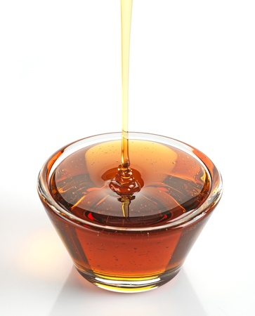 liquid gold: Maple syrup in a bowl on white background