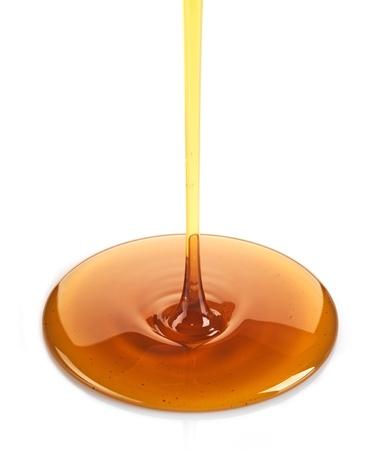 syrup: Jarabe de arce en un fondo blanco