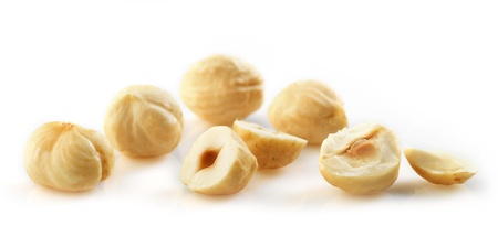 Closeup view of hazelnuts on white background