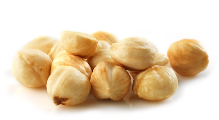 Closeup view of hazelnuts on white background photo