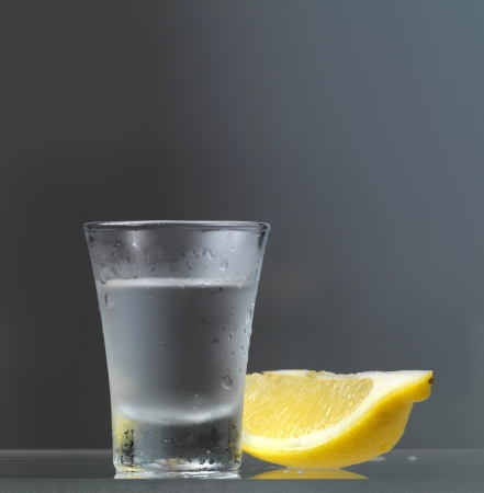 vodka glass with lemon slice photo