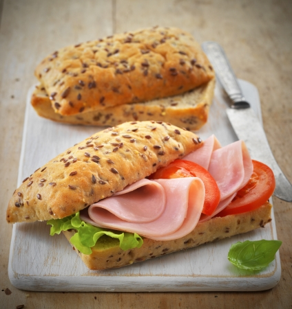 sandwich with pork ham and tomatoes photo