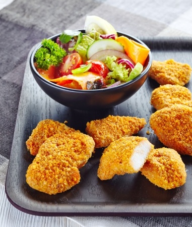 nuggets: chicken nuggets and fresh vegetable salad