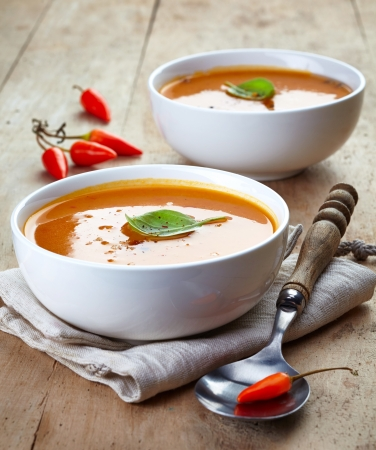 two bowls of squash soup on a wooden table Stock Photo - 21958483