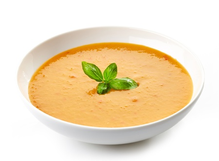 Tazón de sopa de calabaza con hojas de albahaca Foto de archivo - 22001900