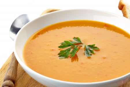 butternut squash: squash soup and parsley leaf in a white plate