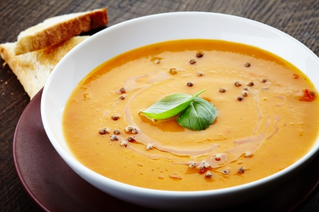 squash soup with basil leaf and spices photo