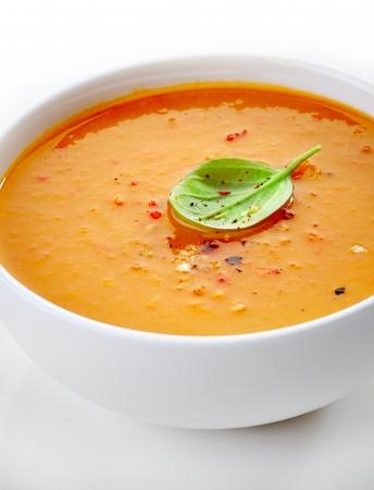 butternut squash: close up of a squash soup bowl