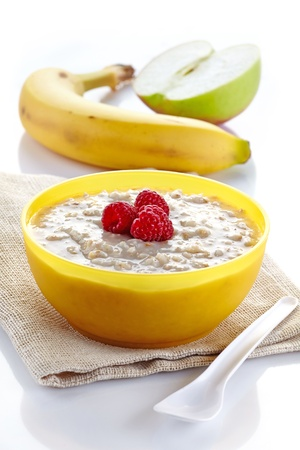 Bowl of oats porridge and fresh fruits photo