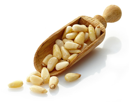 wooden scoop with pine nuts photo